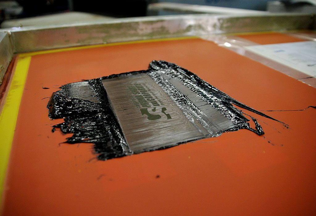 calgary silkscreen logo being slikscreened